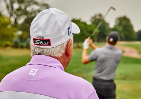 Bob Vokey watches a golfer's swing